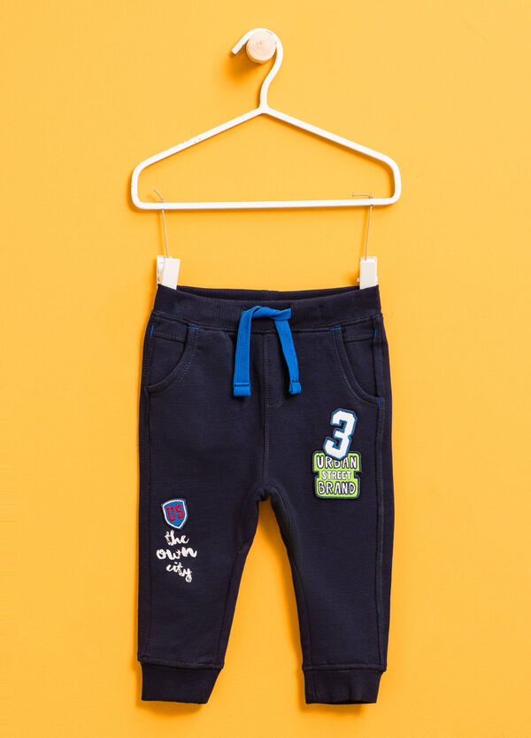 Joggers with patches and lettering print | OVS
