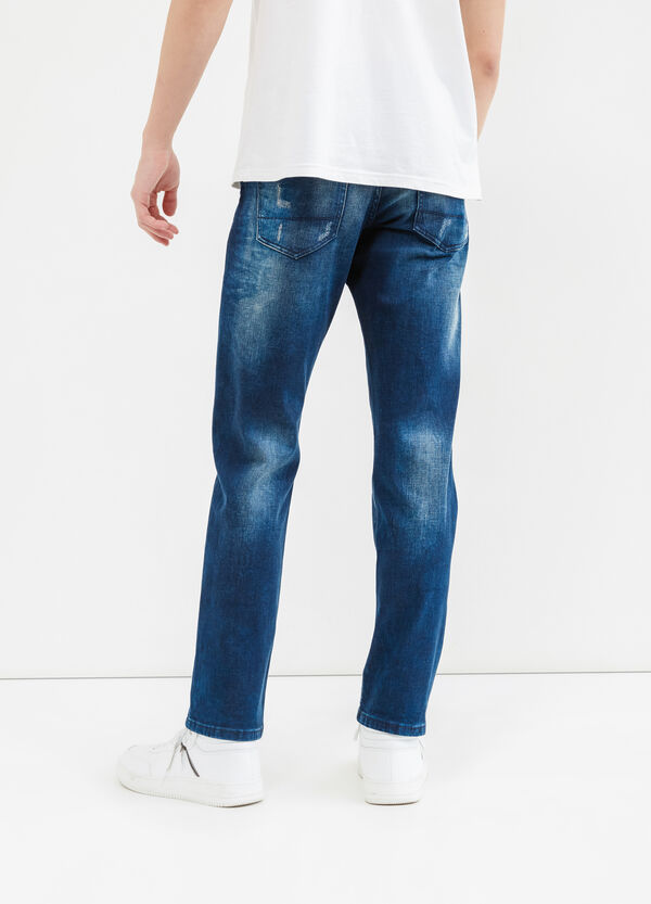 Slim-fit worn-effect stretch jeans with button | OVS