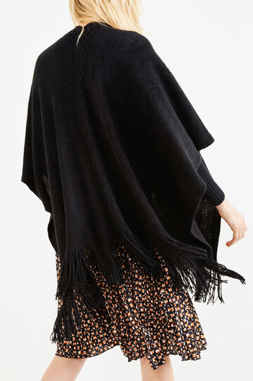 Knitted poncho with solid colour fringing, Black, hi-res