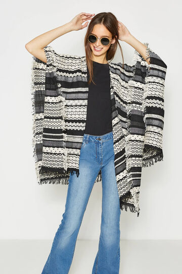 Patterned knitted cape with fringe