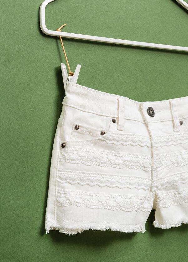 Stretch cotton shorts with fringed hem | OVS