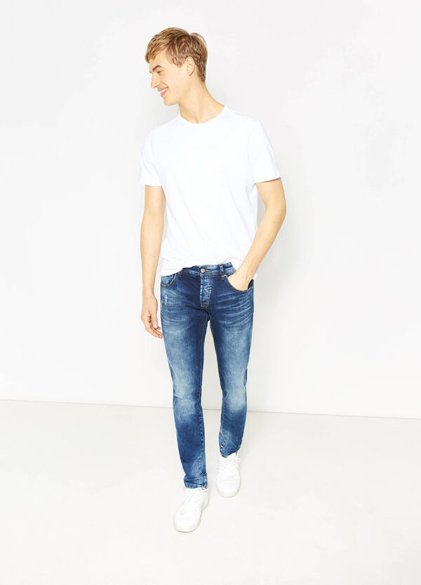 Worn-effect, slim-fit stretch jeans with whiskering | OVS