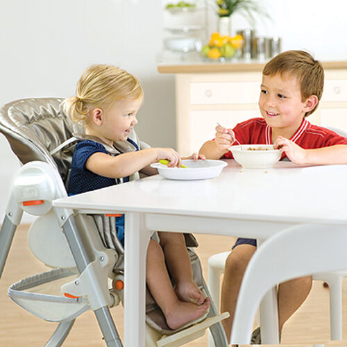 Removable tray and fold-away armrests allow toddlers to sit right up at the dinner table with the rest of the family