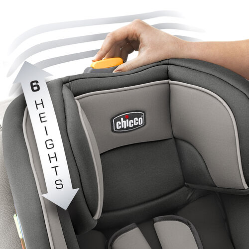 Push the button on top of the NextFit Convertible Car Seat to change the position of the head rest and safety harness shoulder straps