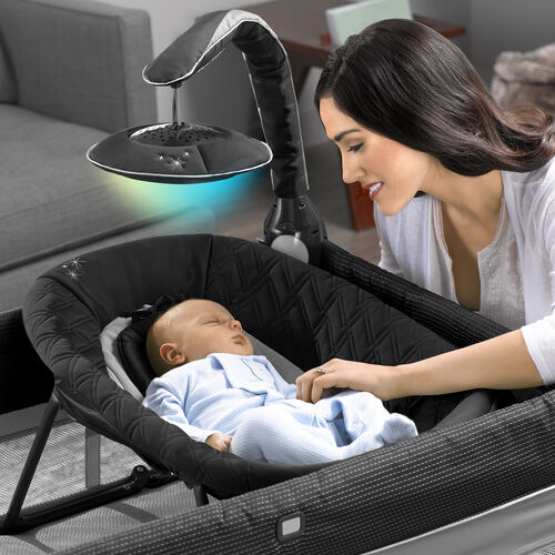 The 2-in-1 newborn napper can be used in the bassinet or on the floor, and folds for storage