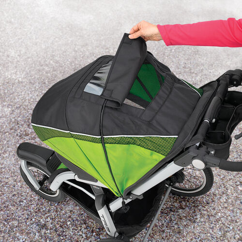 Top canopy flap on the TRE Jogging Stroller allows you to check in on baby