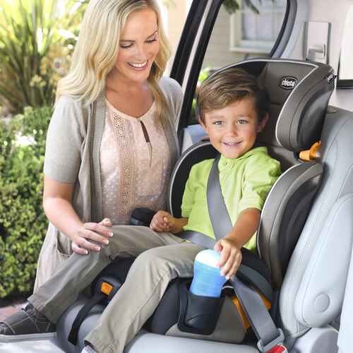 happy child and mother using the Chicco KidFit 2-in-1 Belt Positioning Booster Car Seat