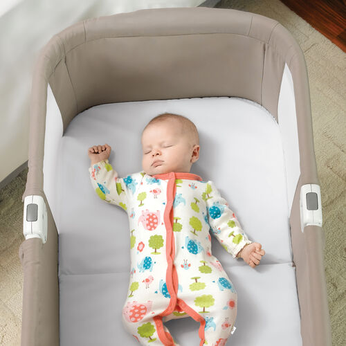 The Lullago Portable Bassinet's mattress keeps baby cozy while sleeping