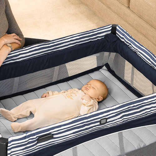 A larger raised bassinet is a comfortable place for baby to rest in the Lullaby Baby Playard