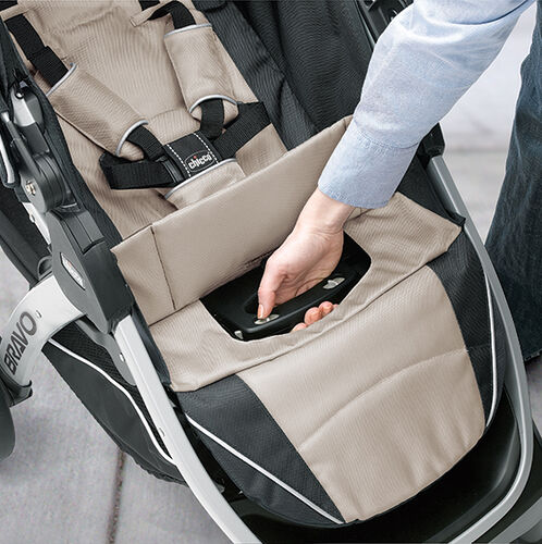 Fold the Bravo Trio Stroller with one hand by pulling up on the folding handle