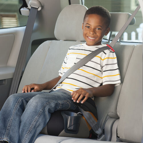 Smiling boy riding in Chicco KidFit 2-in-1 Belt Positioning Booster Car Seat - backless mode