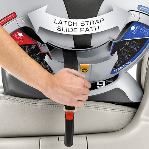Slide the NextFit Convertible Car Seat LATCH straps along the LATCH strap slide path to switch quickly between front-facing and rear-facing
