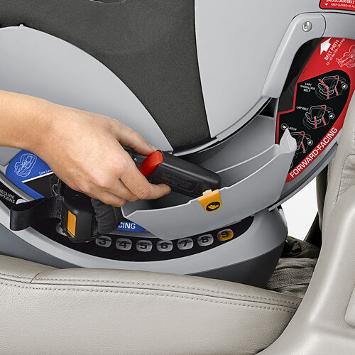 Keep the LATCH connectors and straps in the storage compartments on either side of the NextFit Convertible Car Seat Juno