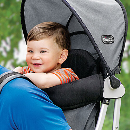 Baby smiling during a ride in the Chicco Smart Support Baby Backpack carrier