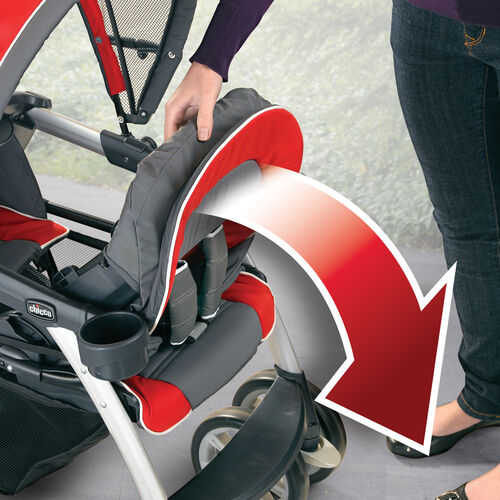 The front seat on the Chicco Cortina Together Double Stroller Elm folds forward to carry a KeyFit 30 Infant Car Seat
