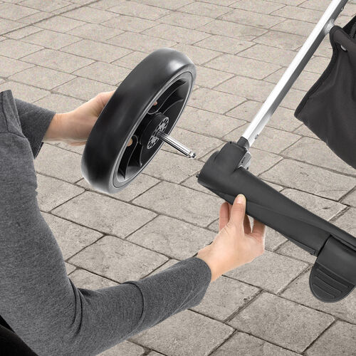 Wheels release from the Chicco Urban 6-in-1 Modular Stroller for a more compact storage fold