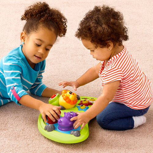 Detach the toy center for floor play or take with you on the go!