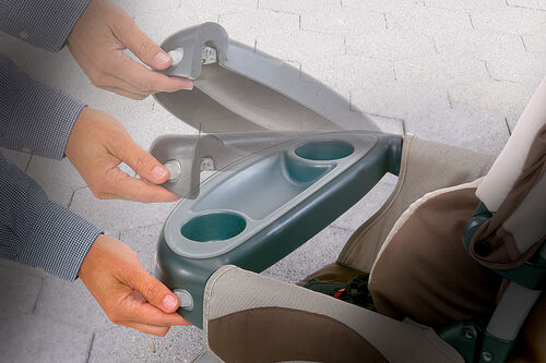 Hinging child's tray allows you to easily load/unload your child from the Cortina Stroller