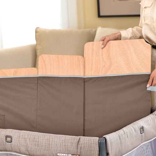 The quilted mattress of the Lullaby Magic Playard has removable floor boards and is machine-washable