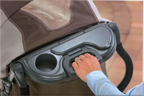 Pull up on the fold handle to fold the Cortina Stroller into a free-standing position