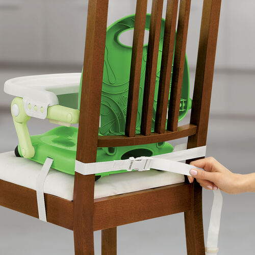 Two attachment straps secure the Pocket Snack Booster Seat to the chair