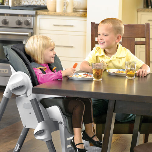The Polly-Highchair's armrests fold away so older children who no longer use the tray can get up close to the table