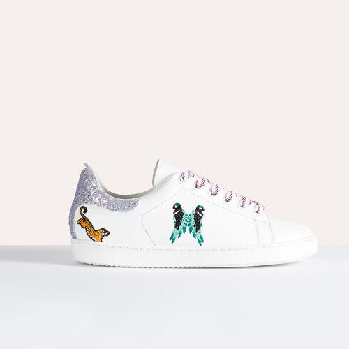 Sneaker aus Leder mit Stickereien - Schuhe - MAJE