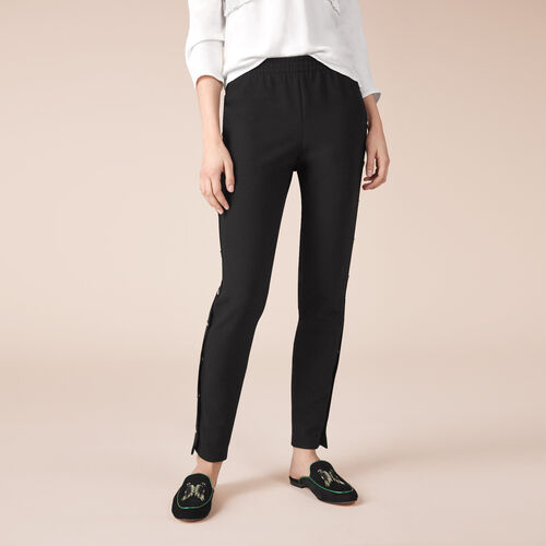 Crêpe trousers with press studs - Trousers - MAJE