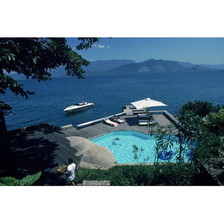 """Slim Aarons - Slim Aarons """"Pool By The Sea"""" Photograph"""