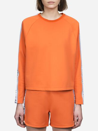 Pull ras du cou femme Tech Club Orange Flow | Peak Performance